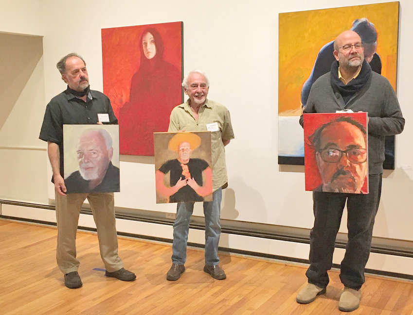 "FEATURED ARTISTS — Local artists John Fitzsimmons, Douglas Whitfield and Tom Montan stand with the portraits they painted of each other inside the Kirkland Art Center gallery Oct. 10.  Their exhibit, ""Portraits, Figures"" runs now through Nov. 20."