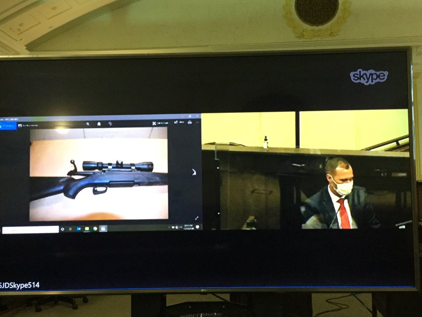 THE WEAPON DISCUSSED — Rome Police Det. Alex Sypniewski discusses the bolt-action rifle that prosecutors said Jason P. D'Avolio used to shoot his wife, Kerrilee, in the back of the head. Sypniewski testified on Thursday about how the rifle was fished out of the Barge Canal.