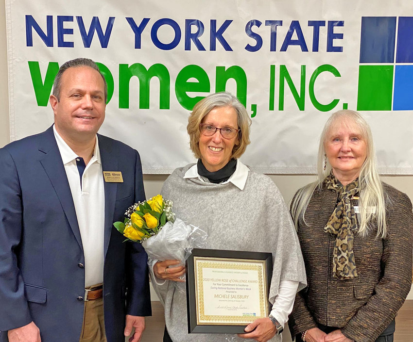STOPPING TO RECEIVE THE ROSES —Michele Salisbury, CFO and director of finance, contracts and diversity as well as board secretary of NYSTEC, flanked by John Calabrese, first vice chairman of the Chamber Board of Directors and Beth Jones, president of the Professional and Business Women of Rome, receives the Yellow Rose of Challenge Award on Friday.