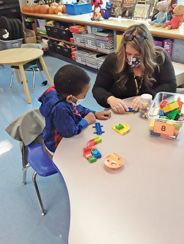 IN-PERSON INTRUCTION — Bellamy Elementary School kindergarten teacher Amanda Pacicca works with a student in her kindergarten class this morning. Rome school district students returned to general education classrooms today for the first time in the current 2020-21 academic year, as part of a hybrid format combining in-person and remote instruction amid the COVID-19 pandemic.