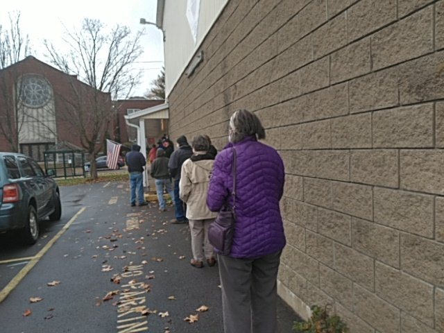 LINING UP TO VOTE — People wait in line outside of the South Rome Senior Center, 112 Ridge St., for early voting to begin on Saturday morning shortly before the poll opened. Early voting is held at three sites in Oneida County.