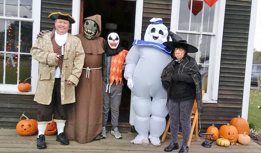 """HAUNTED SCHOOLHOUSE — Ron Klopfanstein, left, with participants at 2019's """"Haunted Schoolhouse"""" event."""