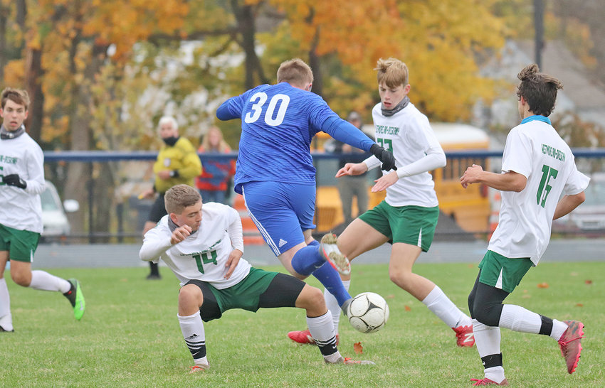 IN TRAFFIC — Poland's Connor Broadbent, middle, weaves his way through three Westmoreland-Oriskany defenders during Tuesday's Center State Conference game. Pictured for the Bulldogs are Johann Bratge, left, Carter McGregor, middle and Christian Uvino. Westmoreland-Oriskany lost the game, 5-1.