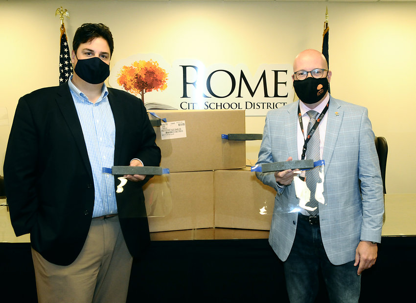 DONATION — Chester DiBari III, executive director of Rome Hospital Foundation, left, and Peter C. Blake, superintendent of schools, Rome City School District, stand in front of boxes of face shields which the foundation donated to help prevent the spread of COVID-19 as students return to in-person instruction.(Photo submitted)