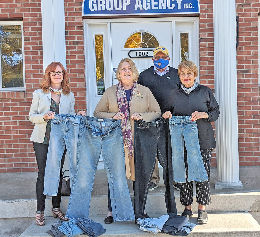 DONATION OF DENIM — Members of the Rome Rotary and Zonta clubs pose with some blue jeans that were recently donated to help the homeless.  The club has listed some dropoff locations where people can safely donate gently-used jeans. From left: Tamara Cantarano, Zonta Club member; Eleanpr Marsh, Zonta Club member; Steve Mercurio, Rome Rotary Club president; and Carla Till, Rome Rotary and Zonta Club member.