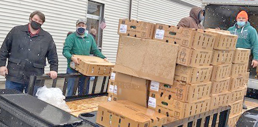 LET'S GET ROASTING! — Volunteers unload some 500 turkeys at the Rome Rescue Mission donated by Kris-Tech Wire on Tuesday.  The company, Rescue Mission officials said, responded in a big way to growing need within the community.