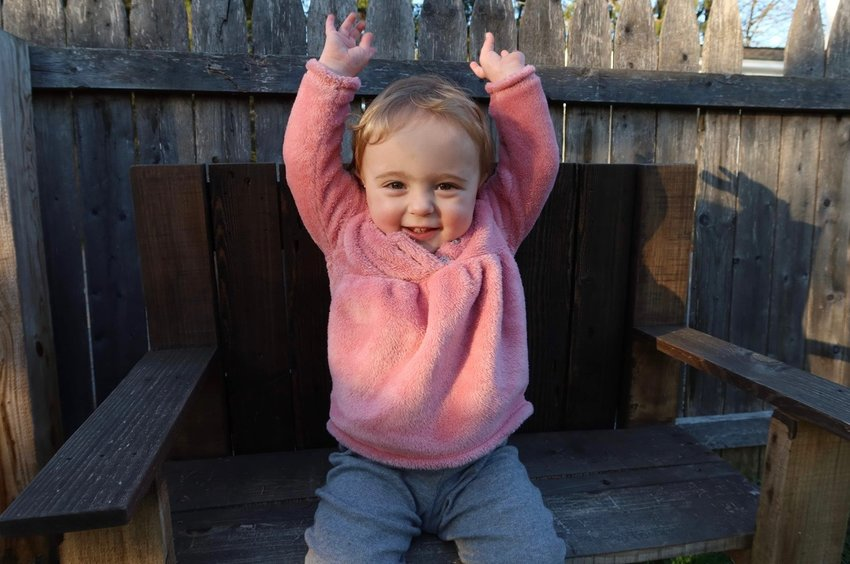 PLAYTIME — Sloane Rose Hurlbut throws up her hands and smiles as she enjoys some recent playtime. The happy, healthy Remsen toddler was born prematurely. Her parents are sharing their story, marking Premature Birth Awareness Month this November with the aim of helping others.