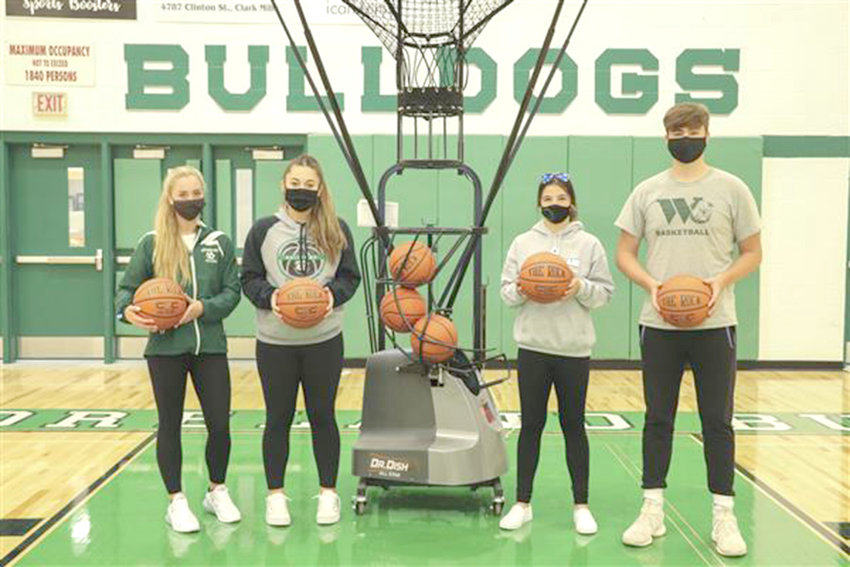 GOOD THROW — Members of the Westmoreland Central School basketball program show off the new basketball shooting machine recently donated by the Edwin J. Wadas Foundation, Inc.