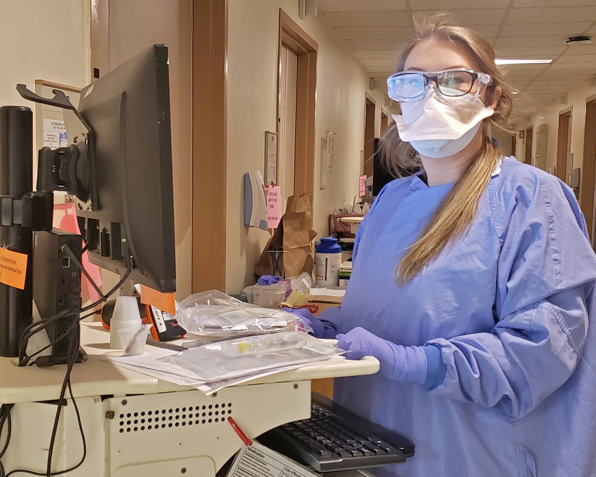 SEPARATE COVID UNIT — Rome Memorial Hospital has a separate unit to isolate positive COVID patients to prevent the spread of the virus.  Nurses, like Erica Bridgman, R.N., wear N95 masks, gowns, eye protection and gloves for their protection when caring for patients who have tested positive for COVID.