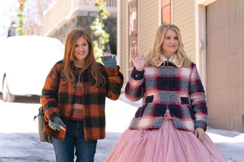 Isla Fisher as Mackenzie Walsh and Jillian Bell as Eleanor in GODMOTHERED, exclusively on Disney+. Photo by K.C. Bailey. © 2020 Disney Enterprises, Inc. All Rights Reserved.