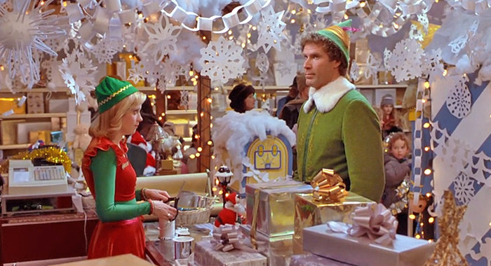 """SEASONAL FAVORITE — Zooey Deschanel and Will Ferrell in a scene from """"Elf."""""""