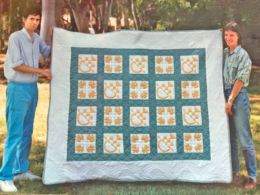 Frank and Rachel holding the wedding quilt they made together, April 1988.