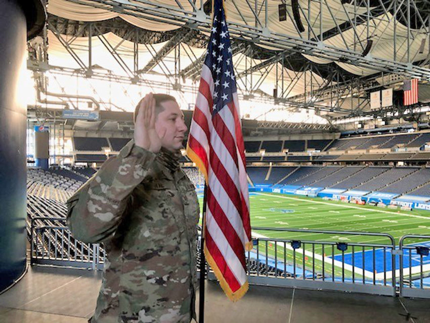SPECIAL CEREMONY —TSgt. Andrew (Drew) Dyal takes his oath of reenlistment in the Air Force, swearing to support and defend the Constitution against all enemies, during a ceremony at Ford Field in Detroit, Mich., earlier this month.