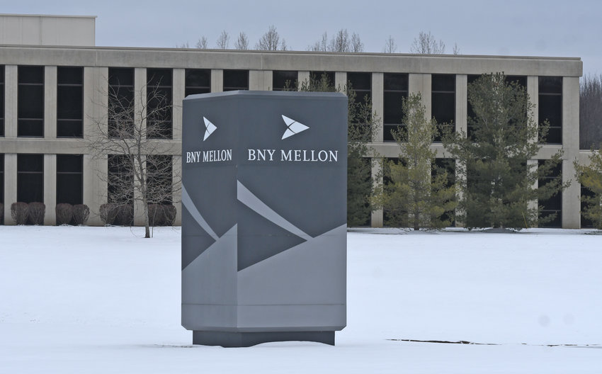 MORE STAFF COMING —BNY Mellon 's faciltiy at the corner of Judd and Airport Roads will receive workers from the financial institution's DeWitt location, which the bank said will close in 2021.