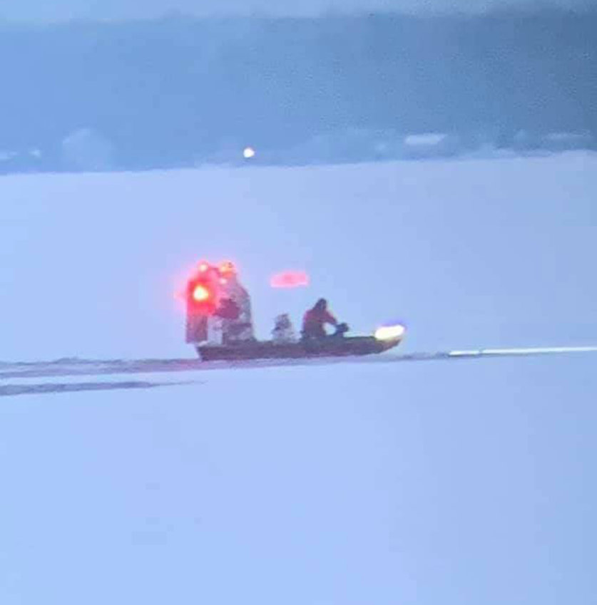 DOG RESCUED FROM LAKE — Sylvan Beach Fire Chief Rick Johnson and Lt. Austin Brown donned ice rescue gear and piloted their air boat onto Oneida Lake Wednesday afternoon and saved a dog that had fallen through thin ice.