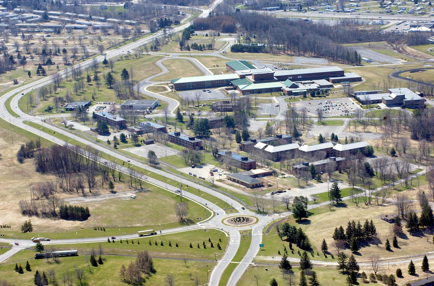 A STEP IN THE TRANSFORMATION —This aerial view of the Griffiss Parkway with its signature roundabout on Route 825 is shown in April 2004 with   Rome Free Academy and Route 49 in the distance. The changes at the 3,500-acre former Air Force-base-turned-business-and-technology park have been striking and have signaled an economic turnaround for the community and region, according to a virtual Rome Historical Society program.
