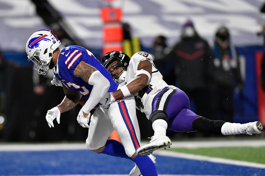 BROKEN UP — Ravens' Marlon Humphrey, right, defends Bills' Gabriel Davis during the first half of an NFL divisional round game last Saturday in Orchard Park.