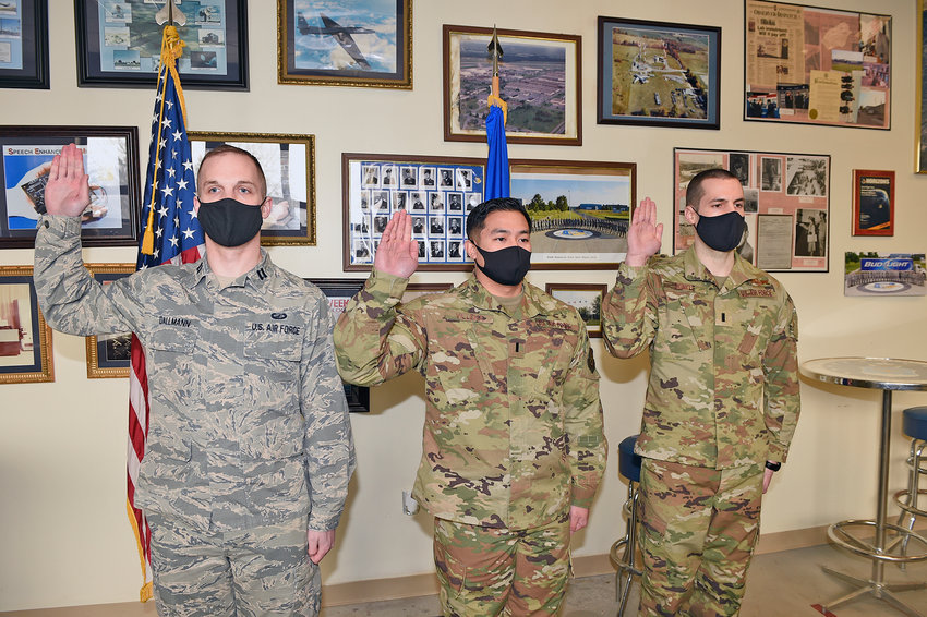 WELCOME TO SPACE FORCE — From left, Capt. William Dallmann, 1st Lt. Rufino Villena, and 1st Lt. William Skinkle swear an Oath of Office to the United States Space Force (USSF). The Rome Lab airmen will support the USSF from the lab.