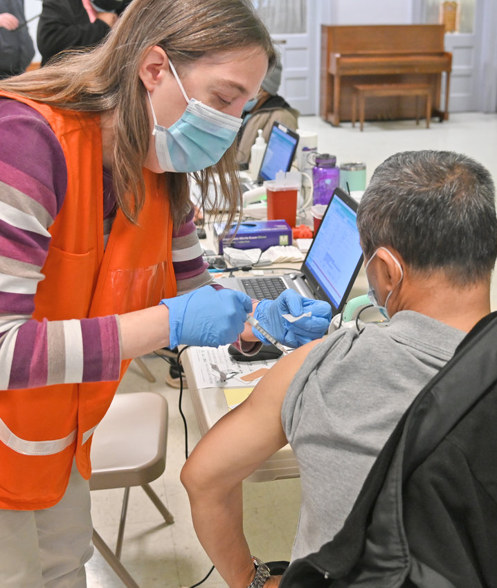 A SHOT IN THE ARM — Vaccinator Patrica Doyle, a registered nurse from Senior Network Health MVHS administers a dose of the Pfizer COVID-19 vaccine to a patient at the pop-up clinic at the Tabernacle Baptist Church in Utica on Monday.