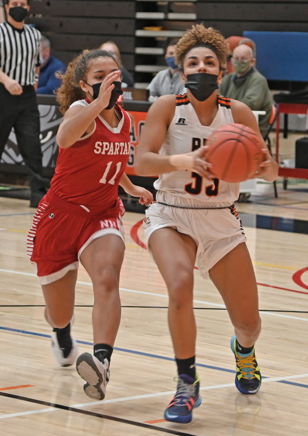 EYES ON THE BUCKET — New Hartford junior guard Kaia Henderson, left, chases Rome Free Academy sophomore guard Amya McLeod to the basket during Tuesday night's Tri-Valley League contest at RFA. McLeod finished with a team-high 26 points.