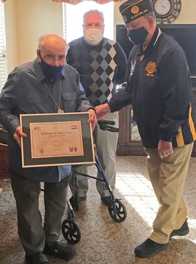 """DUTCH HONOR — Helmuth-Ingalls American Legion Post 232 Adjutant Ken Shilkret, right, presents a special commemoration to decorated veteran Kenneth C. Thayer, of Clinton, during a ceremony Thursday.  In the background is friend and author Allan D. Foote, who wrote two books about the """"young liberators"""" — soldiers of the K-Company, 3rd Battalion, 119th Regiment, 30th Infantry Division, known as """"Old Hickory.""""(Sentinel photos by Nicole A. Hawley)"""