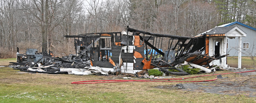 TOTAL LOSS — All that remains of the vacant Westmoreland Community Church on East Main Street following a fire early Monday morning.