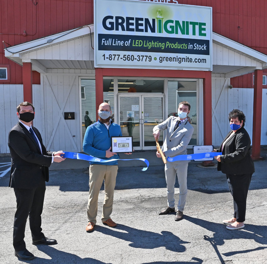RIBBON-CUTTING — Viktor Klyachko, president of Green Ignite, LLC, 312 S. James St., cuts the ribbon and receives a First Dollar of Profit award from the Rome Area Chamber of Commerce, during a ceremony at the new store on Tuesday. Green Ignite offers a variety of LED lighting products that provide solutions to people who want to save money on their utility bills, have better lighting, and more lighting options using different styles of LED light bulbs, according to a chamber announcement. The store is open Monday through Friday from 8 a.m. to 5 p.m. From left: Michael Stadelmaier, from Rep. Claudia L. Tenney's office; Rome Area Chamber of Commerce Chairman Adam Hovak;  Klyachko and Ann Marie Zakala, representing Assemblywoman Marianne Buttenschon. For information about Green Ignite, go online to https://greenignite.com/  or call the store at 315-601-9612.