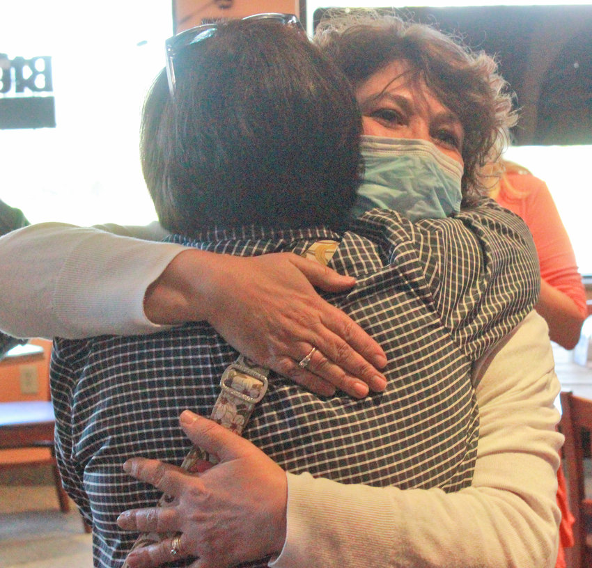 RETIREMENT PARTY — Patti Meakin embraces one of her friends after being surprised with a party at Origlio's Wagon Wheel, celebrating all the work she's done over the last 17 years at the city of Oneida.