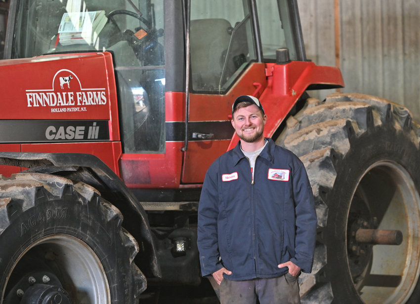 NIcholas Finn with a tractor that he spends a lot of time at Finndale Farms in Holland Patent