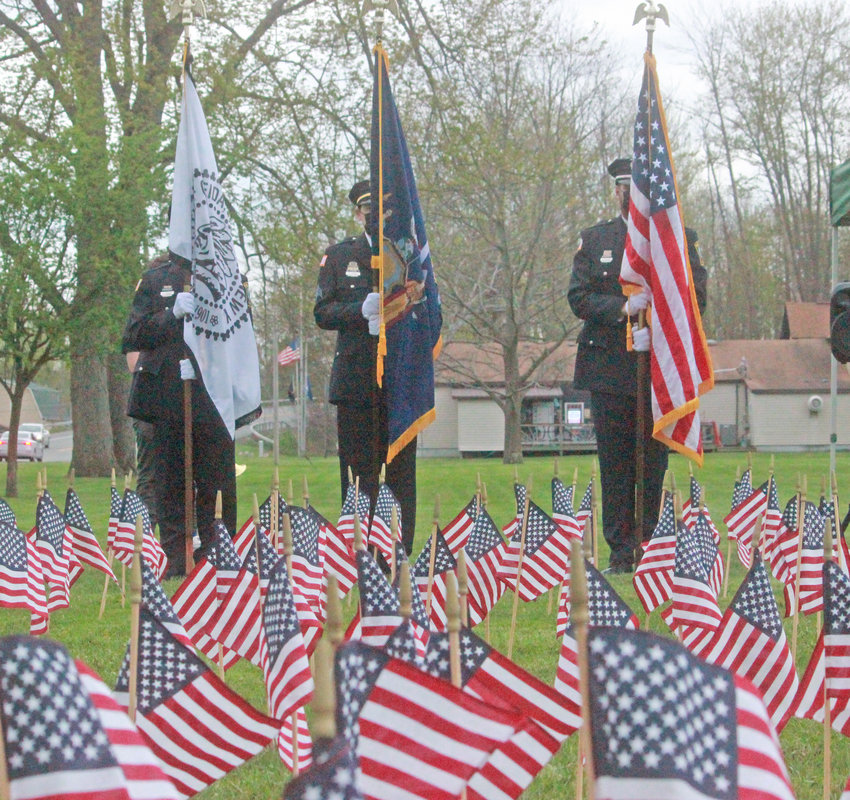 REMEMBERING THE FALLEN — The Oneida Police Department's Color Guard stands at attention at the Memorial Flag Garden at Veteran's Field in Oneida.