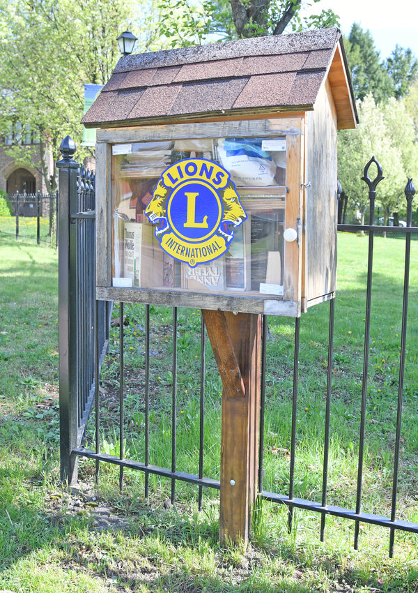 NEED A READ? — The Rome Lions Club book box sits fully stacked at the Rome Art and Community Center, 308 W. Bloomfield St. People looking for a book to read can peruse the selections while those with a book to donate can drop them off inside the box. A bench, suitable for a leisurely read, sits nearby.