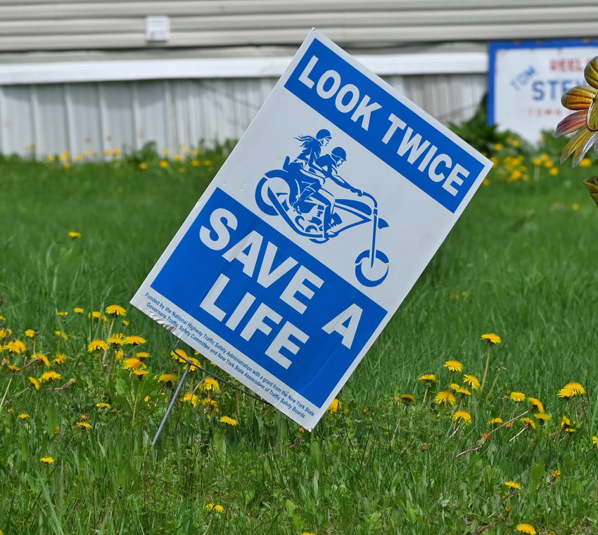 """BE VIGILANT — A sign urges motorists to """"Look Twice, Save a Life"""" in Western this week.  Officials warn that fatal motorcycle crashes rose at a dramatic rate in 2020."""
