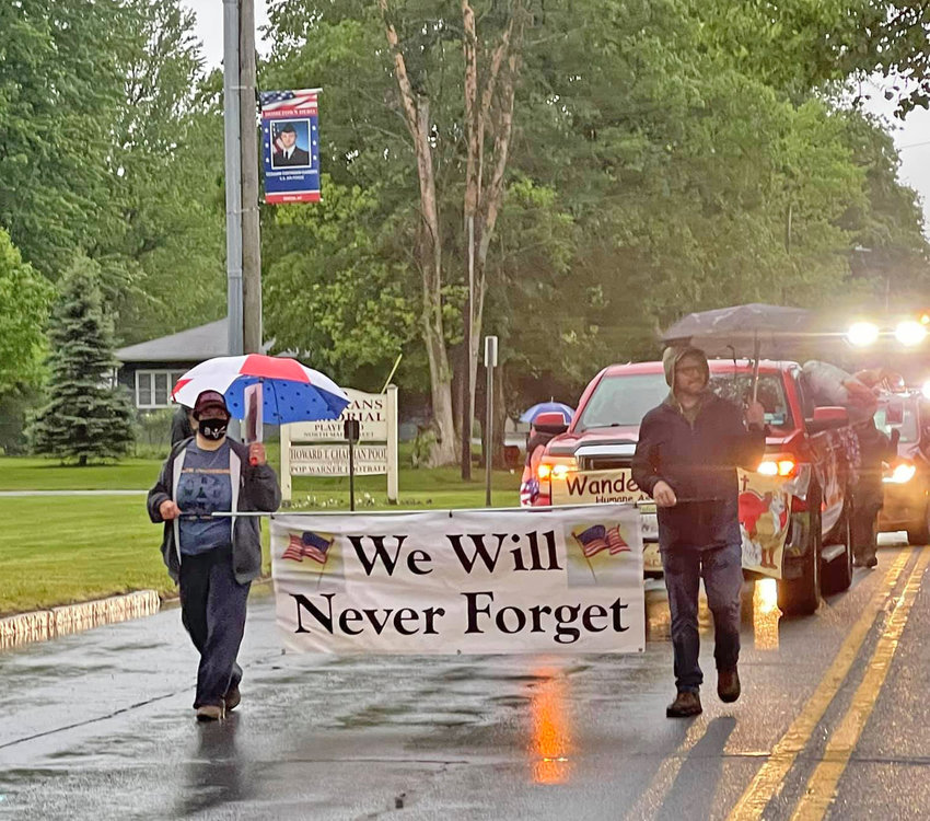 NEVER FORGET — Though it rained and poured, residents of the greater Oneida area came out for the Oneida Memorial Day Parade to celebrate Memorial Day and honor those that made the ultimate sacrifice.