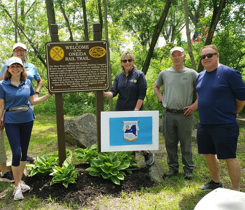 EXPLORING THE TRAILS — Members of the Oneida Rotary Club hit the Oneida Rail Trail before the club's luncheon meeting at the Madison Bistro. The club has adopted a spot to keep clean on the trail.