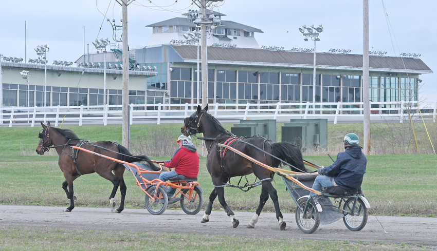 RACING FOR SIGNATURE — Horses are being exercised at Vernon Downs in this file photo from the fabled harness racing track. A bill that would provide some financial relief to the racino has been passed by both houses of the State Legislature — with area lawmakers hoping Gov. Andrew M. Cuomo will race to sign the measure into law.