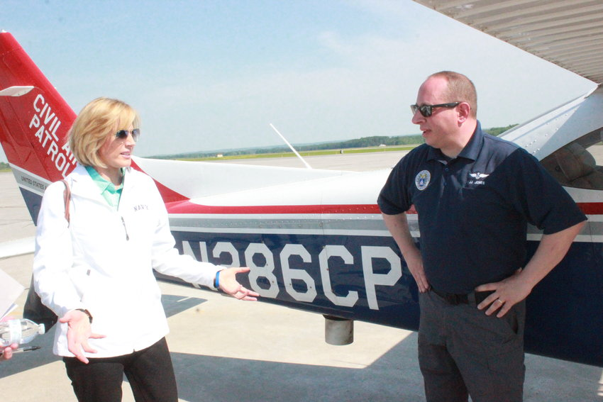 CIVIL AIR PATROL —Rep. Claudia L. Tenney, R-22, New Hartford, speaks with Civil Air Patrol  New York Wing Commander Col. John Jones before they go up to tour the 22nd Congressional District. (Sentinel photo by Charles Pritchard)