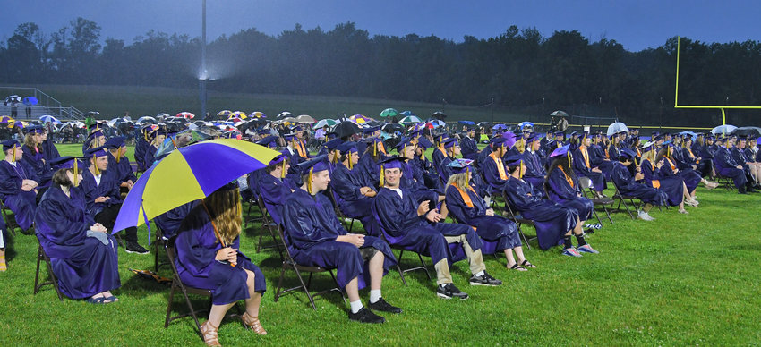 Drenched HP graduates