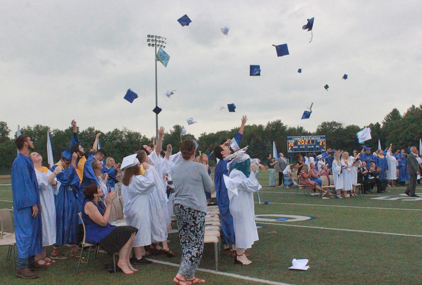 CELEBRATING — The Camden Class of 2021 toss their caps in the air to mark the end of the graduation ceremony.