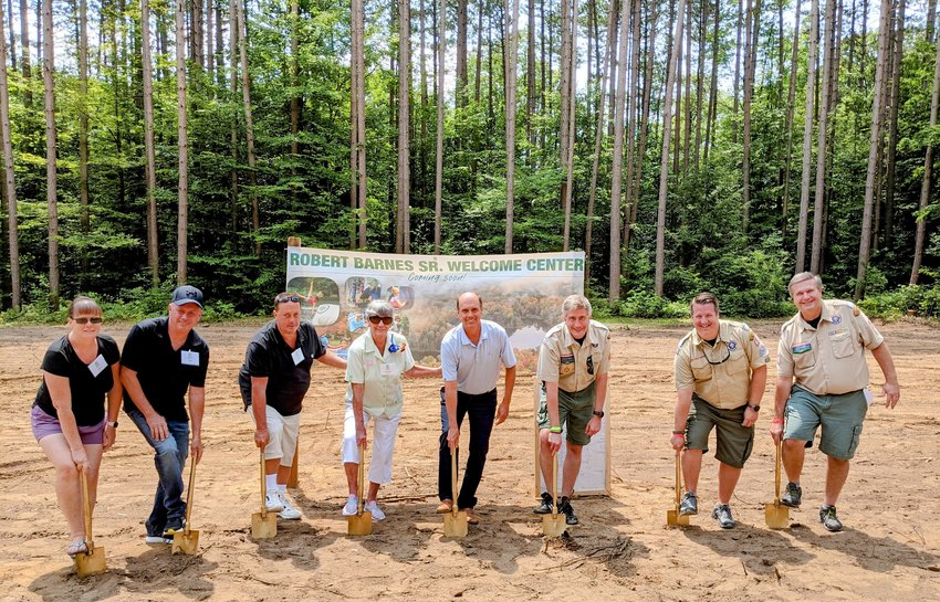 """GETTING READY FOR BIG WELCOME (CENTER) — Boy Scout officials, volunteers and donors break ground for the soon-to-be constructed Robert G. """"Bob"""" Barnes, Sr. Welcome Center at Camp Kinglsey, 5328 Tuffy Road, off of North Ava Road, in Ava. The facility, officials said, will be a warm and inviting space for guests to check into camp, relax in the lounge, use the restroom upon arrival and even take care of their health paperwork. From left: Sally Barnes; Bob Barnes, Jr.; Bill Barnes; Patricia Barnes; Steve Barnes; Rob Mahardy, camp director; Matthew Dziedzic, council president; and Raymond Eschenbach, Leatherstocking Council CEO."""