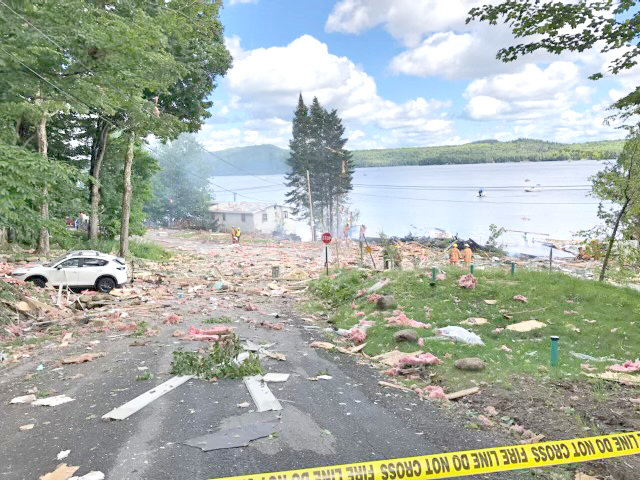 DAMAGE AND DEBRIS — All that remains of this lakeside home in Old Forge is debris strewn about on the edge of First Lake following an explosion Friday afternoon. Officials said one person was injured. The cause remains under investigation.
