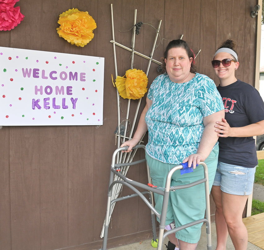HOME, SWEET HOME — Kelly Lubeck arrives home with her daughter, Alyssa Lubeck, after having been in the hospital and a Schenectady rehabilitation hospital for eight months since diagnosed with COVID-19 back in January.
