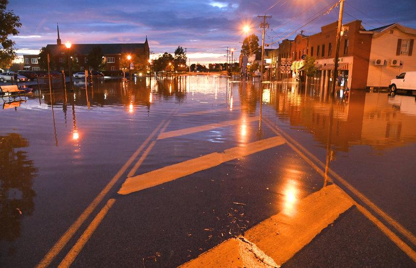 Flood water across East Dominick St. Thursday evening.