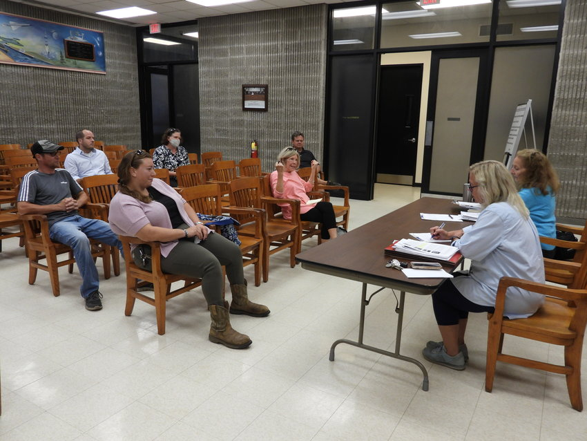 DOWNTOWN DISCUSSIONS — Oneida residents sit down with Planning Director Cassie Rose to put the finishing touches and additions to a grant application New York State's Downtown Revitalization Initiative on Tuesday, Aug. 24.