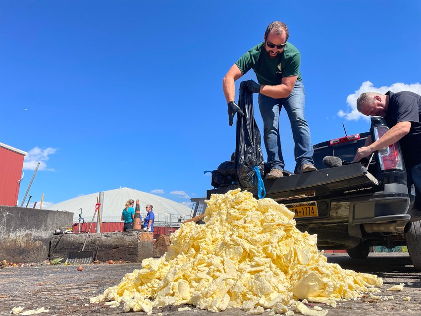 READY TO RECYCLE — The buttery remains of this year's State Fair butter sculpture are processed for a biodigester which will turn the former attraction into energy. The sculpture will produce enough energy to run a home for about three days.