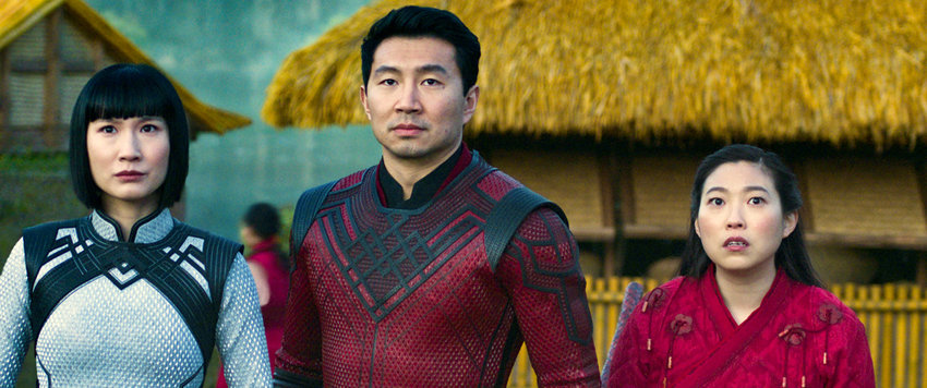 """Martial arts action flick — Meng'er Zhang, Simu Liu and Awkwafina in a scene from """"Shang-Chi and the Legend of the Ten Rings."""""""