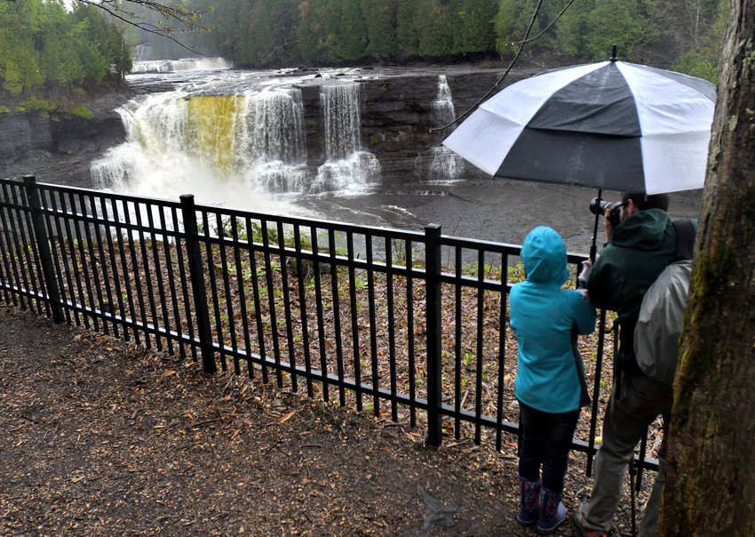 GORGEOUS VIEWS —Spectators take photos of the Upper Falls from the Trenton Falls Scenic Trail in this file photo from May 2017. The trails were scheduled to be open this weekend; however, a lack of volunteers have forced town officials to cancel the fall opening of the trails.