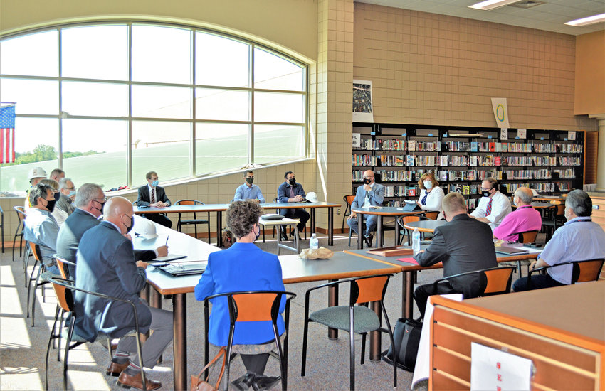 ROOF SESSION — Start, local and school district officials meet last week in the Rome Free Academy library to discuss accountability and future steps in regards to the failed roof at RFA.