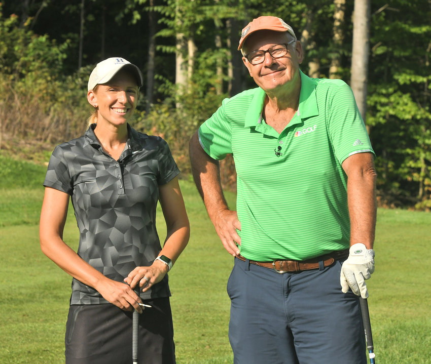 """PICTURE TIME — Rome's Lauren Cupp and NBC's Harry Smith pose for a picture on the 12th tee at Rome Country Club last month. Smith followed Cupp around for a """"Today Show"""" feature on her record-breaking round of Speedgolf during the Thirsty Owl New York Speedgolf Open on Aug. 8. The piece will air Friday morning between 8:30 and 9."""
