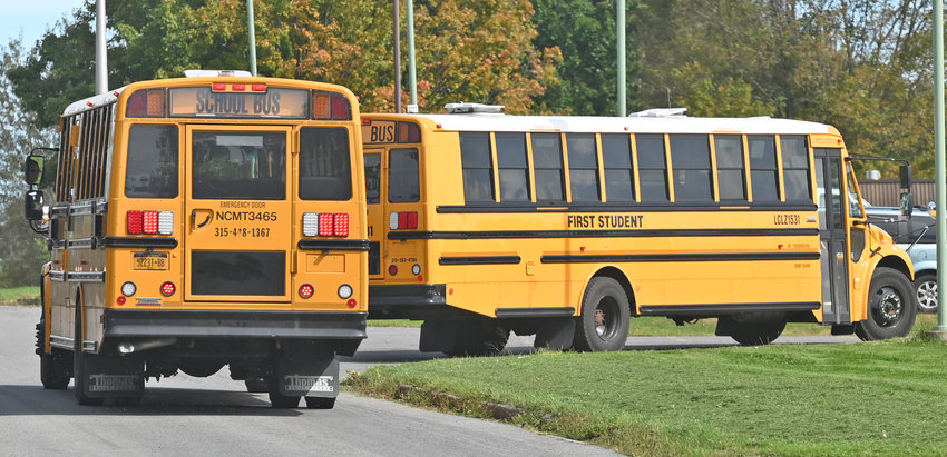 AFTERNOON PICKUP — First Student buses are pictured pulling into the Rome Free Academy driveway at 95 Dart Circle for the afternoon pickup on Tuesday.
