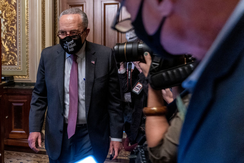 MORE DISCUSSION — Senate Majority Leader Sen. Chuck Schumer of New York leaves a Senate Democratic meeting at the Capitol in Washington Wednesday as a showdown looms with Republicans over raising the debt limit.
